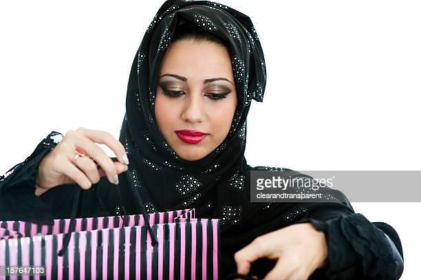 Happy Arabic girl shopping
