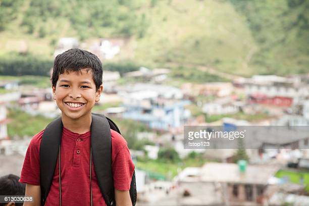 Happy, Asian descent boy outdoors in Indian city.