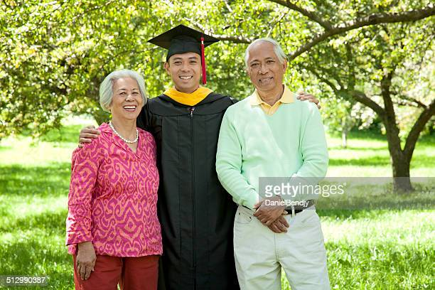 Happy Asian Family Graduation Portrait