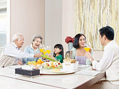 three-generation family having meal at home.