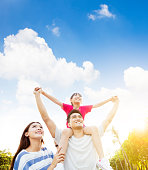 happy asian family with cloud background