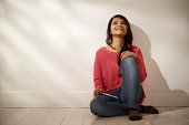 Women and health, relaxed Asian girl looking at pregnancy test kit sitting on floor at home