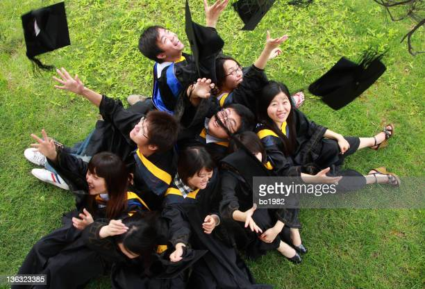happy asian graduates