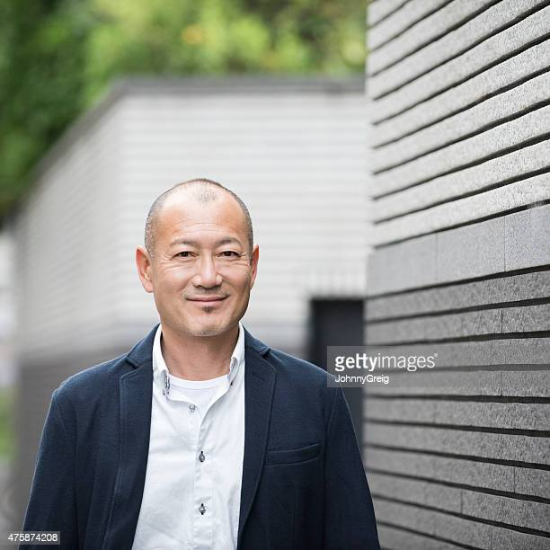 Happy Asian man smiling