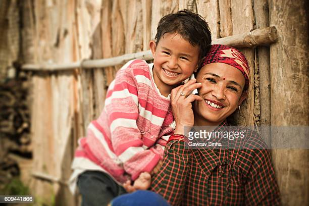 Happy Asian mother and daughter on the phone.