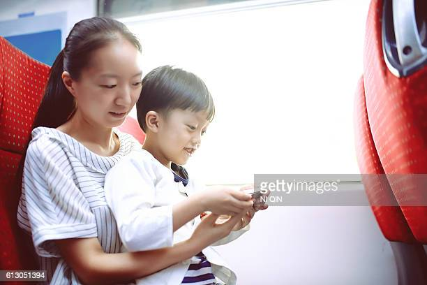 Happy Asian mother and son Using Smart Phone