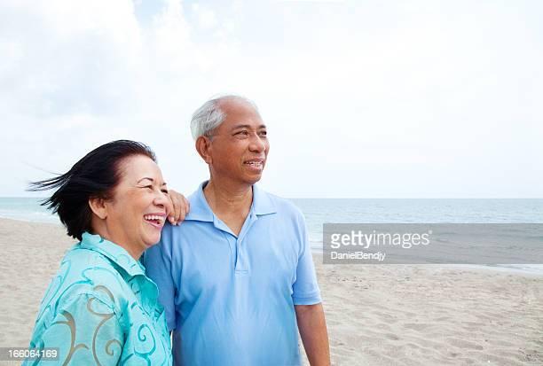 Happy Asian Retiree Couple on Beach