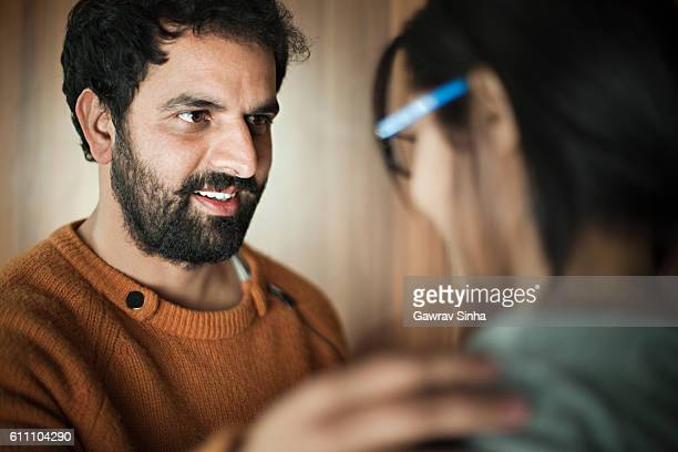 Happy Asian young man and woman talking face to face.