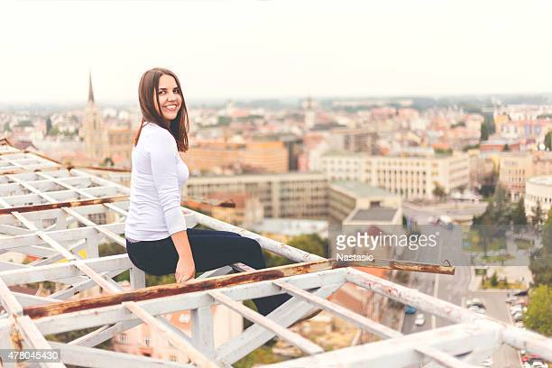 Happy attractive girl sitting on balcony