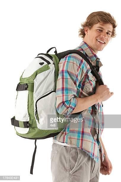 Glücklich attraktive junger Mann mit einem Rucksack