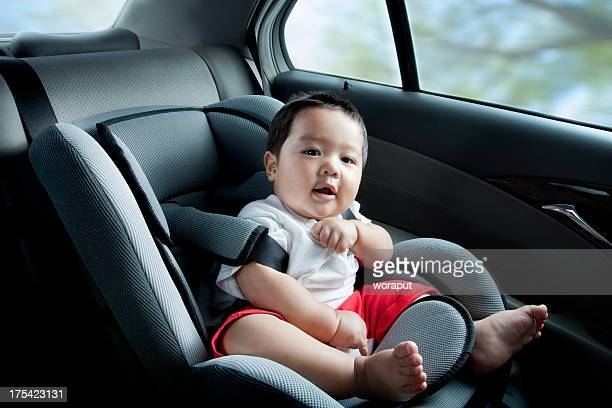 Happy baby boy in car seat