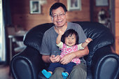 Happy baby girl and grandfather