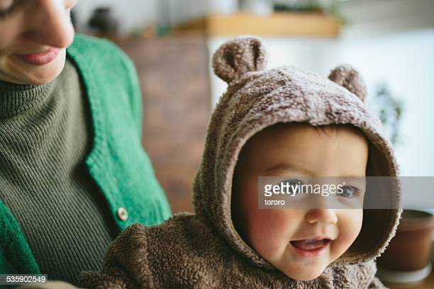 Happy baby in bear costume