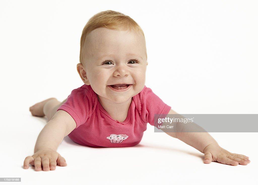 Happy Baby On White Seamless Background Stock Photo