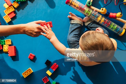 Happy baby playing with toy blocks. : Stock Photo