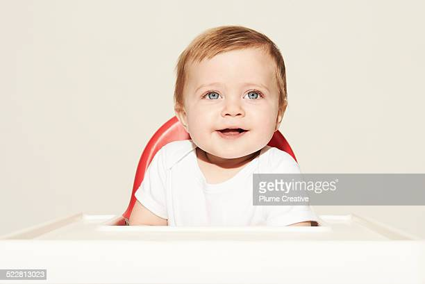 Happy baby sat in high chair