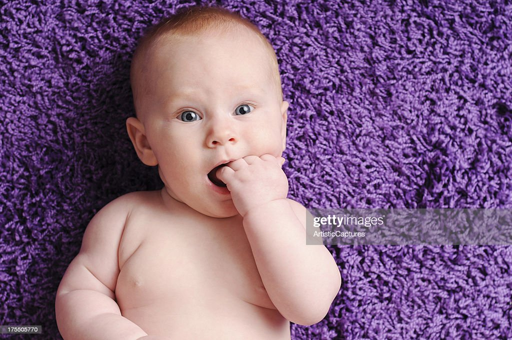 'Happy Baby Sucking on Fingers, With Copy Space' : Stock Photo