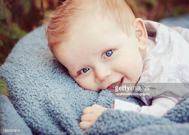 Happy baby with blue-eyed