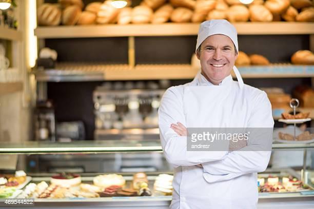 Happy baker at the bakery