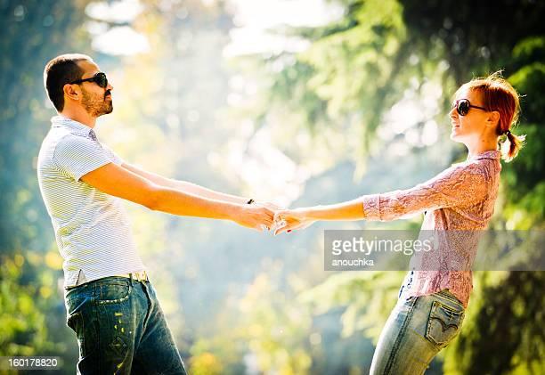 Happy Beautiful couple Having Fun Outdoors