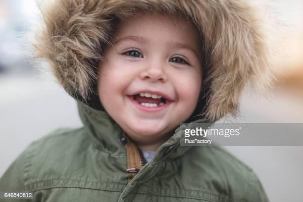 Happy beautiful toddler girl close up