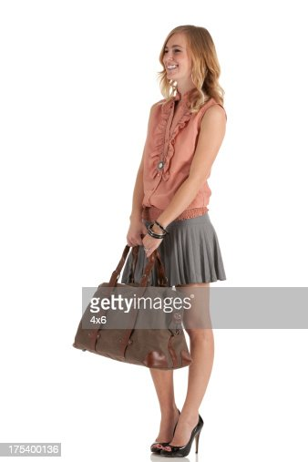 Woman Standing With A Bag Stock Photo | Getty Images