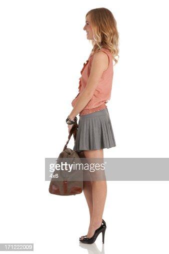 Happy beautiful woman carrying hand bag