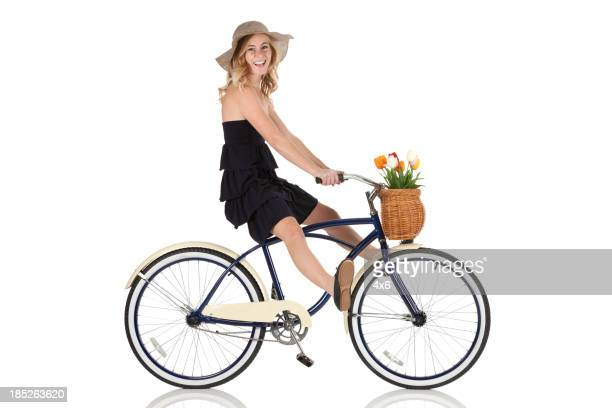 Happy beautiful woman riding a bicycle