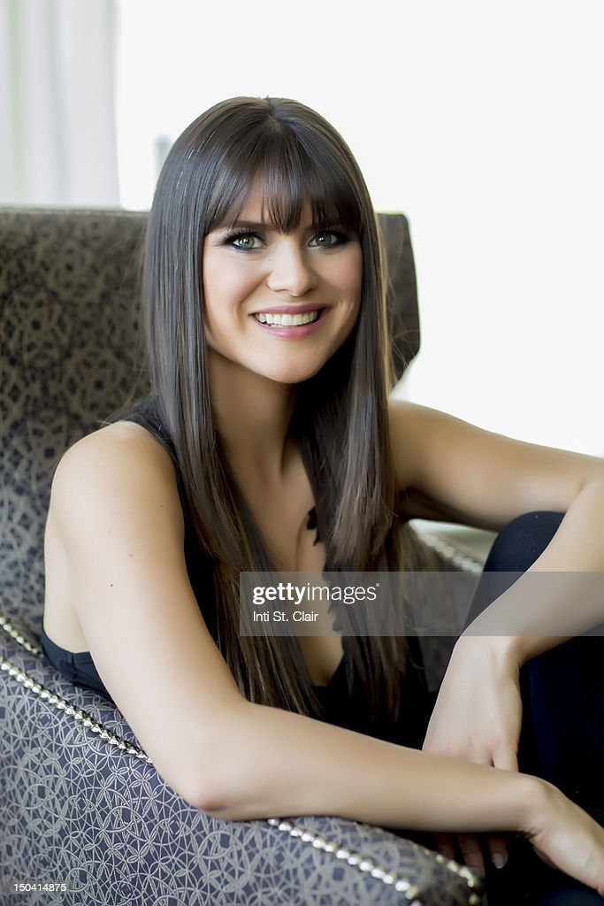 Happy beautiful woman sitting in modern chair : Stock Photo