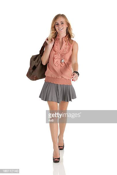 Happy beautiful woman with a bag