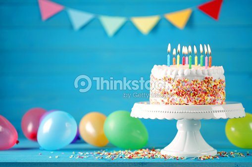 Happy Birthday Cake With Burning Candles Balloons And Pennant Stock Photo