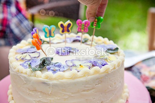 Happy Birthday Cake With Butterfly Candles And Real Edible Flowers