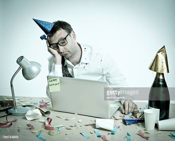 Happy Birthday, hungover man behind laptop, office interior, retro look