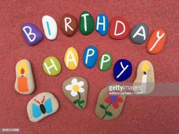 Happy birthday massage on pebble stone