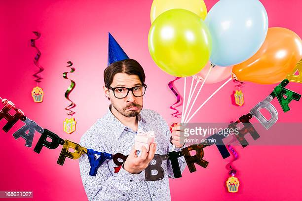 Happy birthday, Nerdy man making faces, holding gift, multicolored balloons