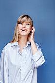 Happy blond beauty in blue shirt, portrait