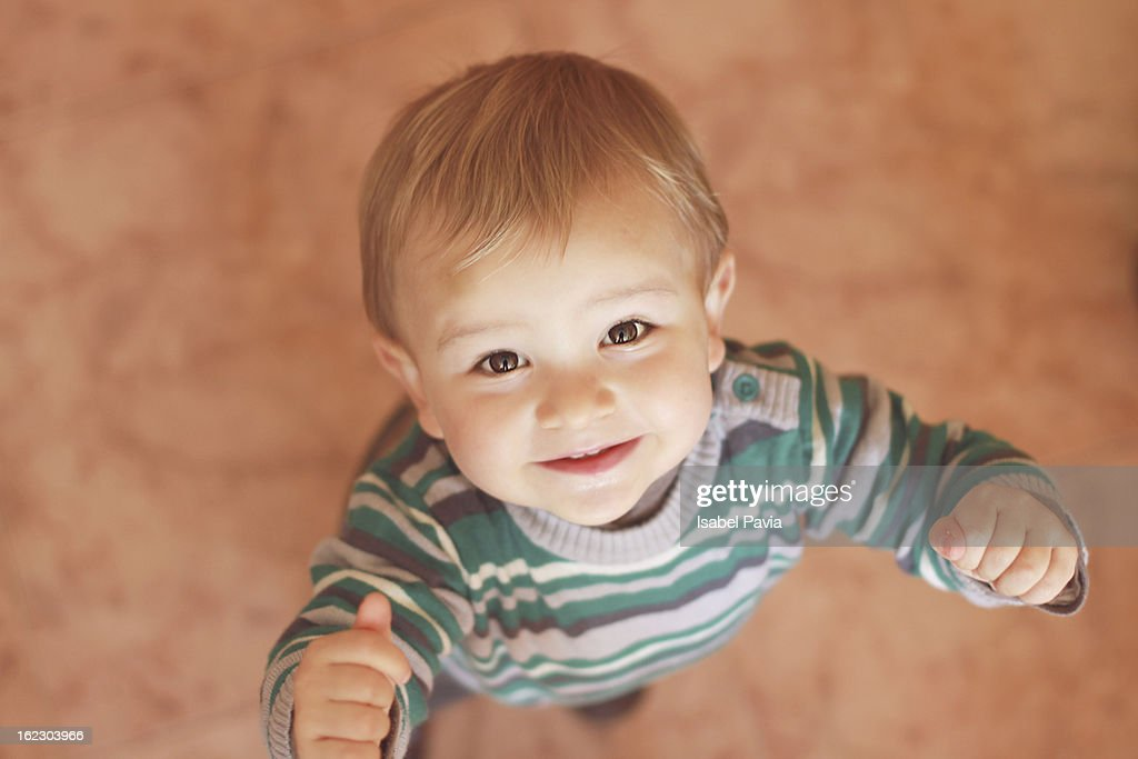 Happy blonde baby boy : Stock Photo