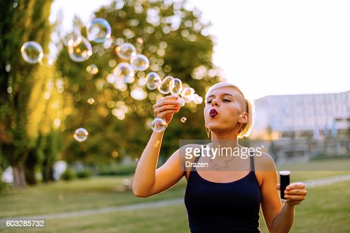 Happy blonde woman enjoys day in park