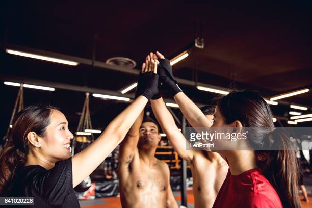 Happy boxing team celebrate together after workout