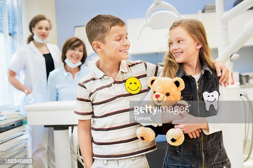 Happy Boy and Girl at the Dentist : Stock Photo