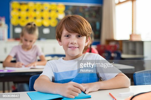 Happy boy at elementary school : Stock Photo