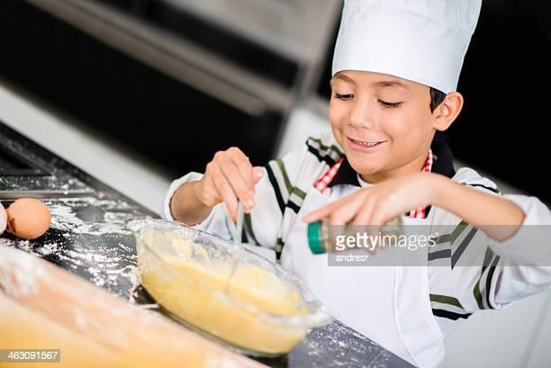 Happy boy cooking dinner