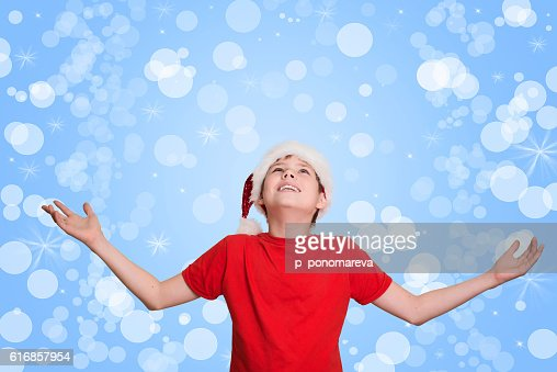 Happy boy hands up waiting for Christmas. Christmastime. : Stock Photo