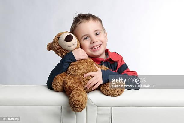 'Happy Boy hugging teddy bear, portrait'