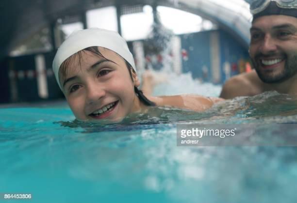 Happy boy in a swimming class