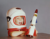 Happy Boy in Astronaut Costume with Spaceship