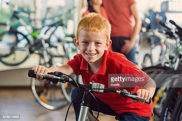Happy boy in bike store