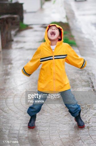 Happy boy in the rain