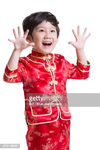happy boy in traditional clothing celebrating chinese new year stock photo getty images. Black Bedroom Furniture Sets. Home Design Ideas
