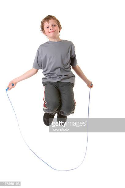 happy boy jumping rope